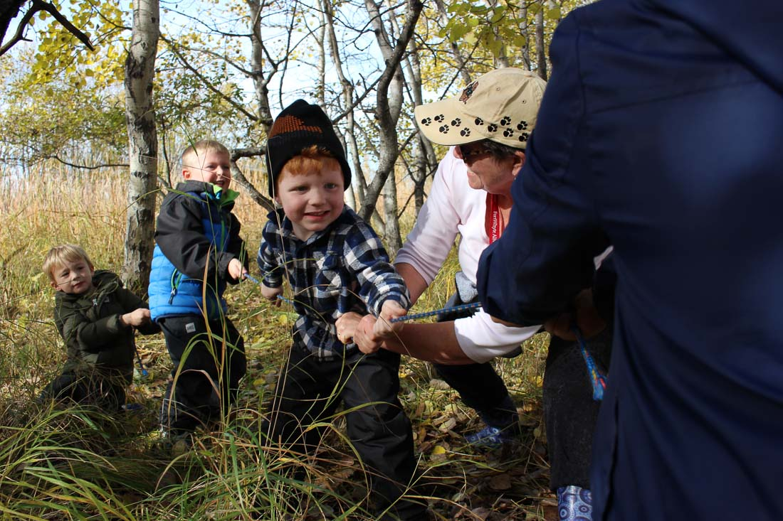 Children of Forest School playing tug-of-war