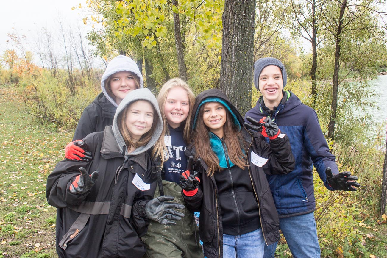 High school students gathered together and smiling at Water Ecology Day