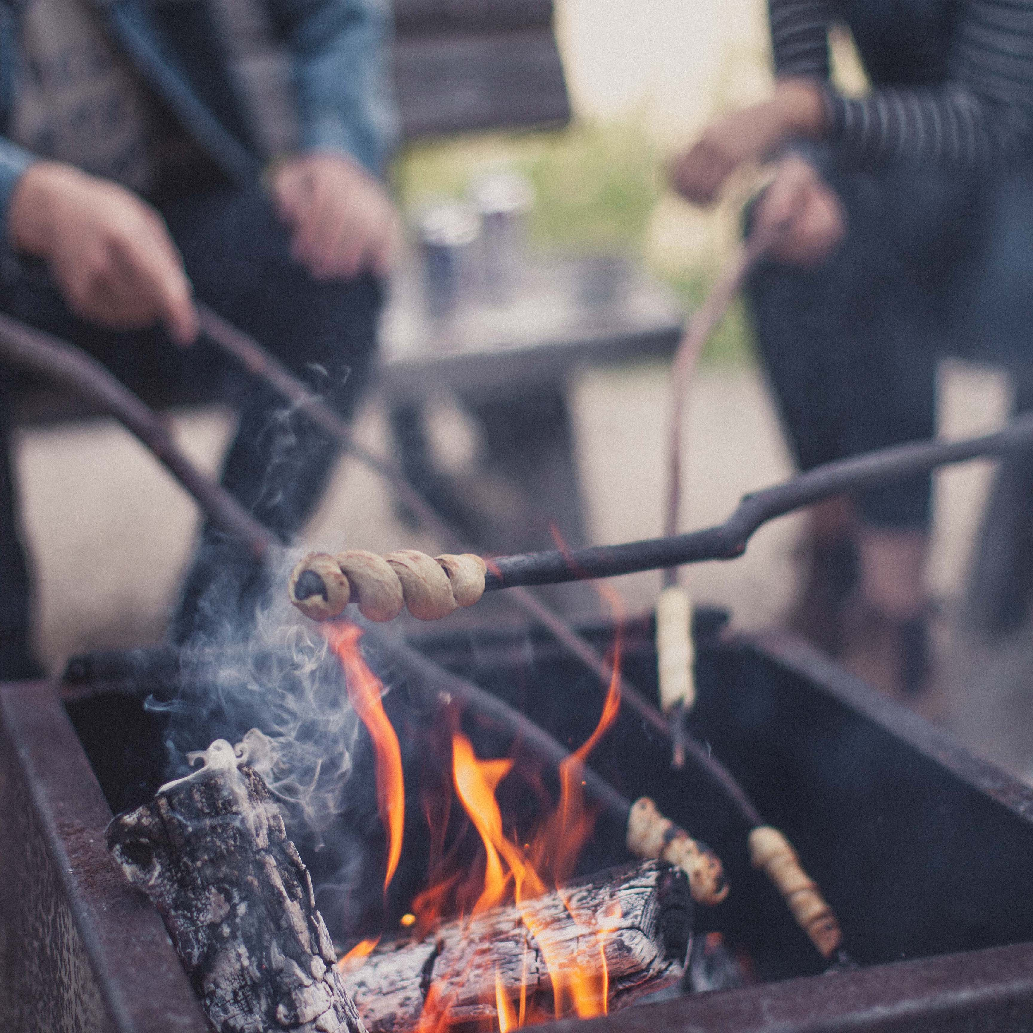 Roasting bannock over a bonfire