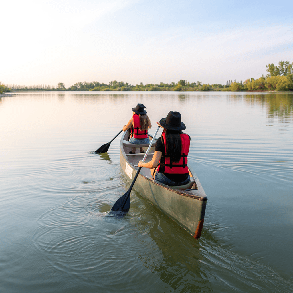 Two paddlers out in a canoe at FortWhyte Alive