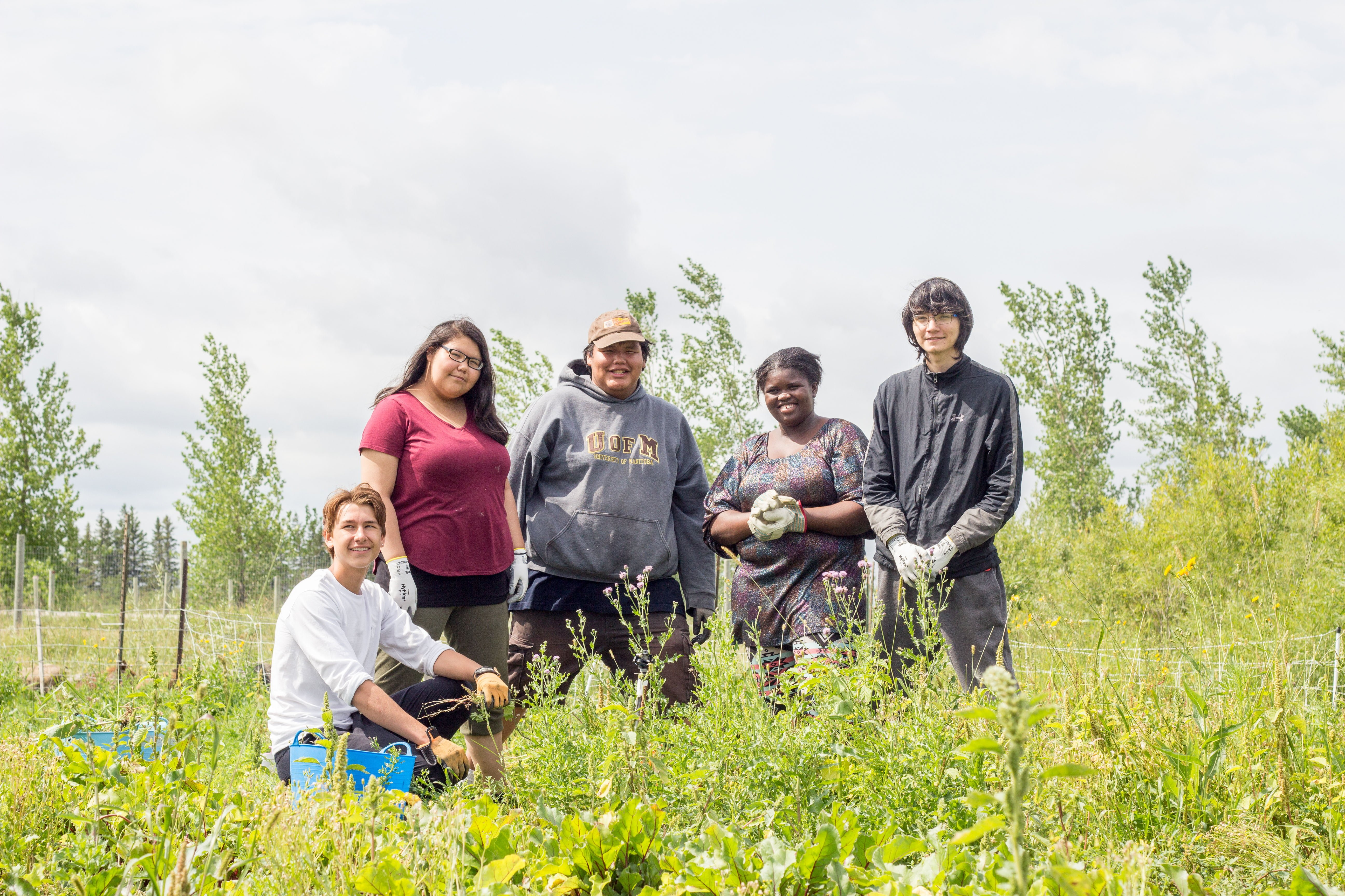 Group of FortWhyte Farms Junior Staff working in the garden.