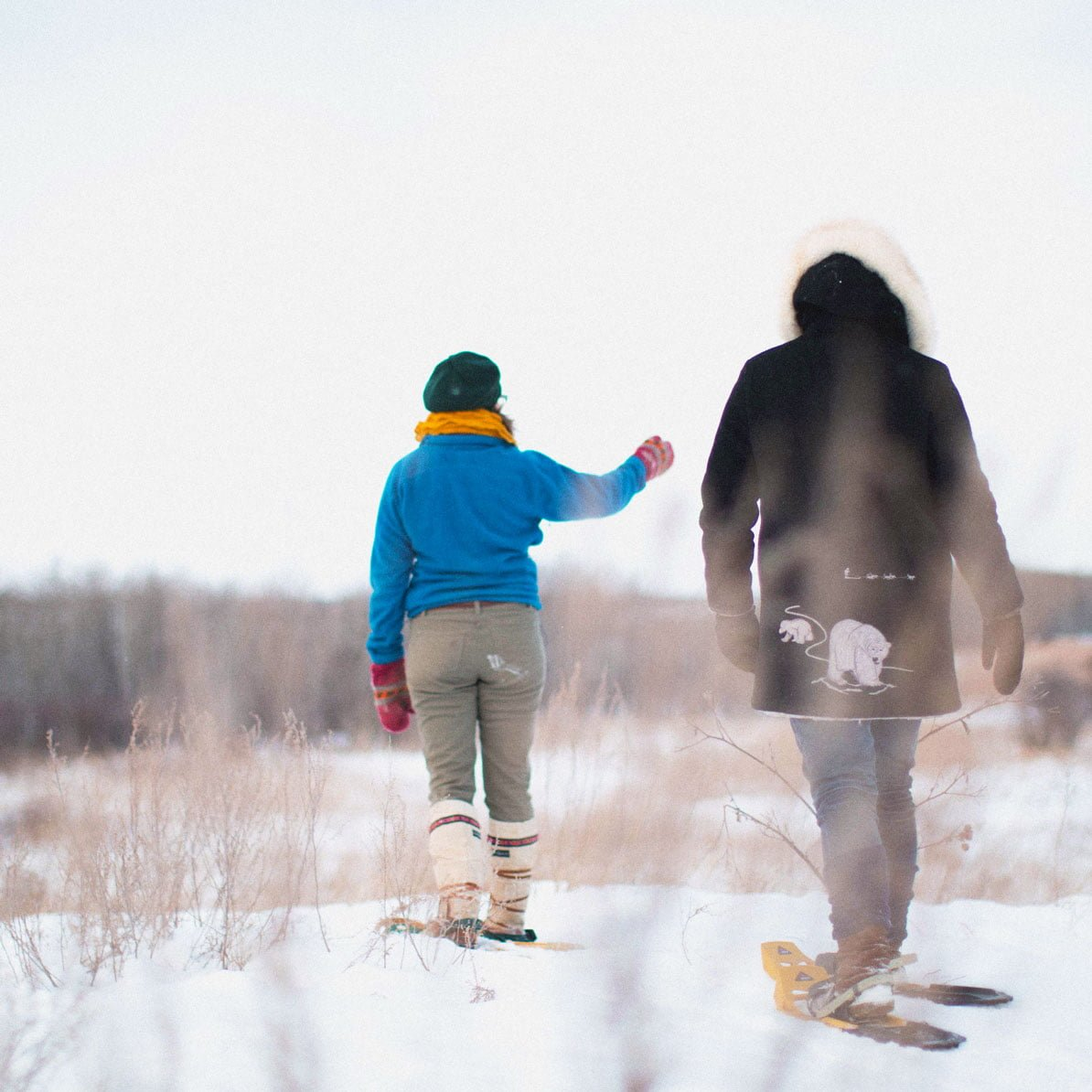 Two visitors snowshoeing at FortWhyte Alive.