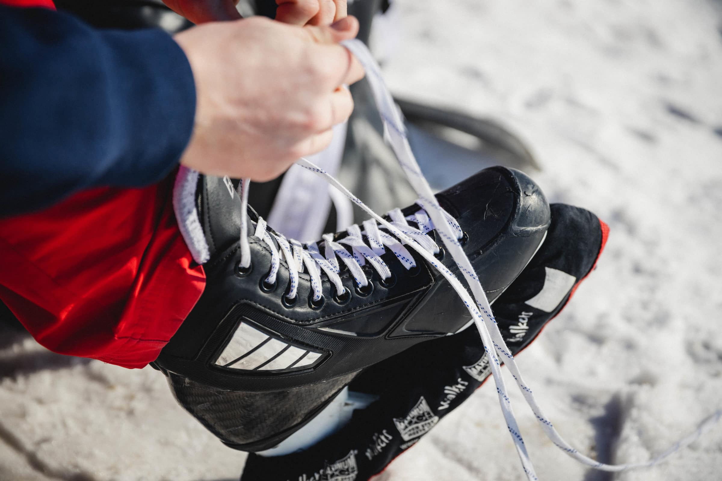 Hands tying up a skate