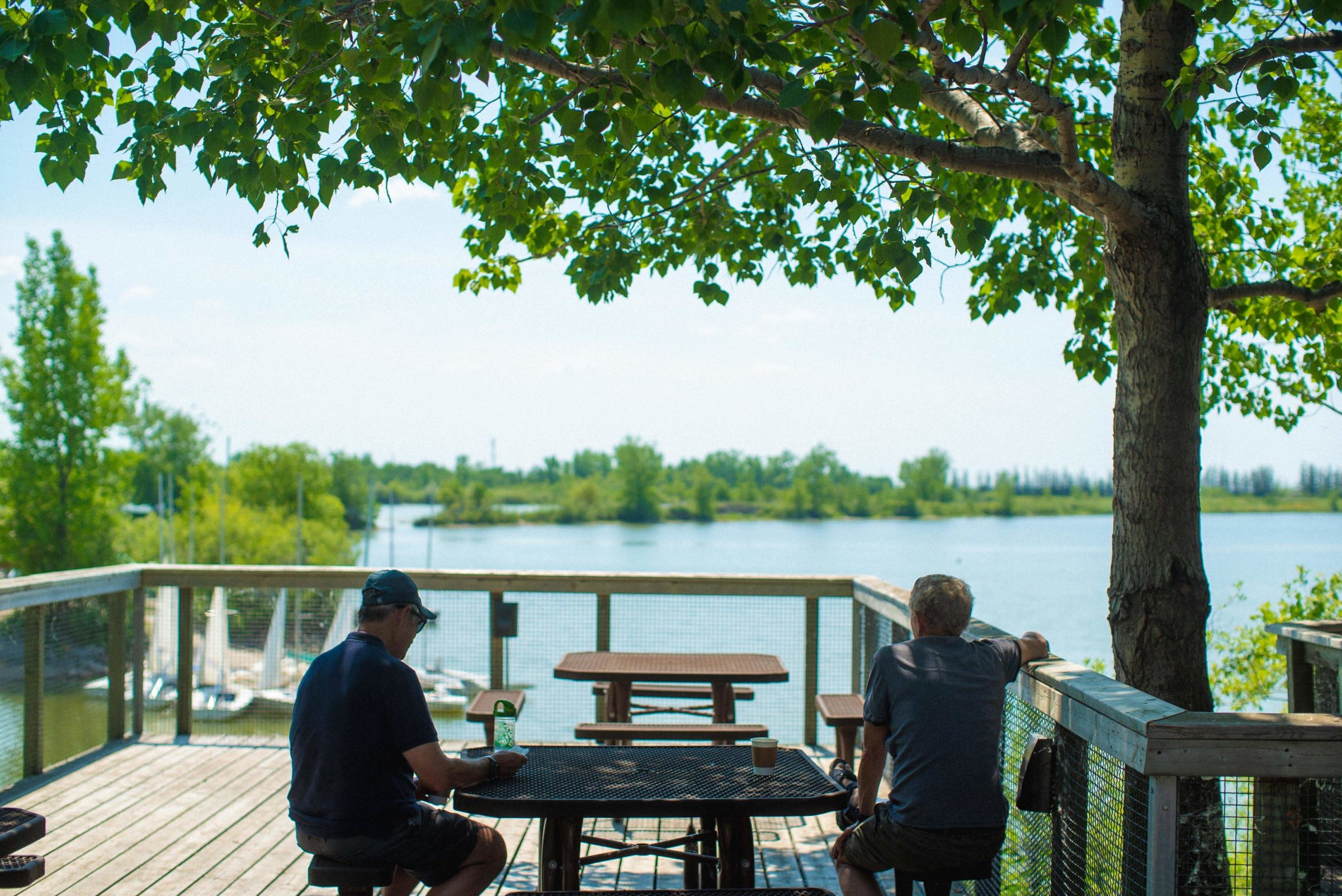 Two visitors take in the patio view at The Buffalo Stone Cafe.