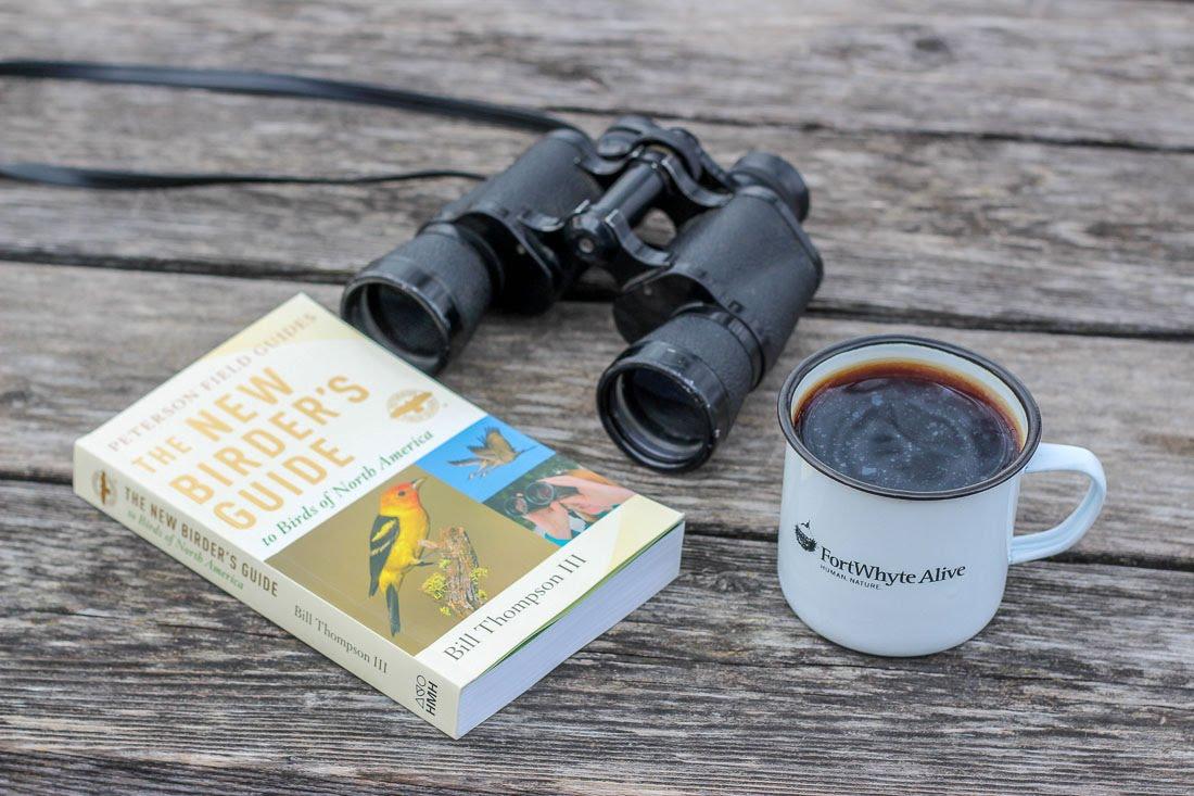 Binoculars and birding book.