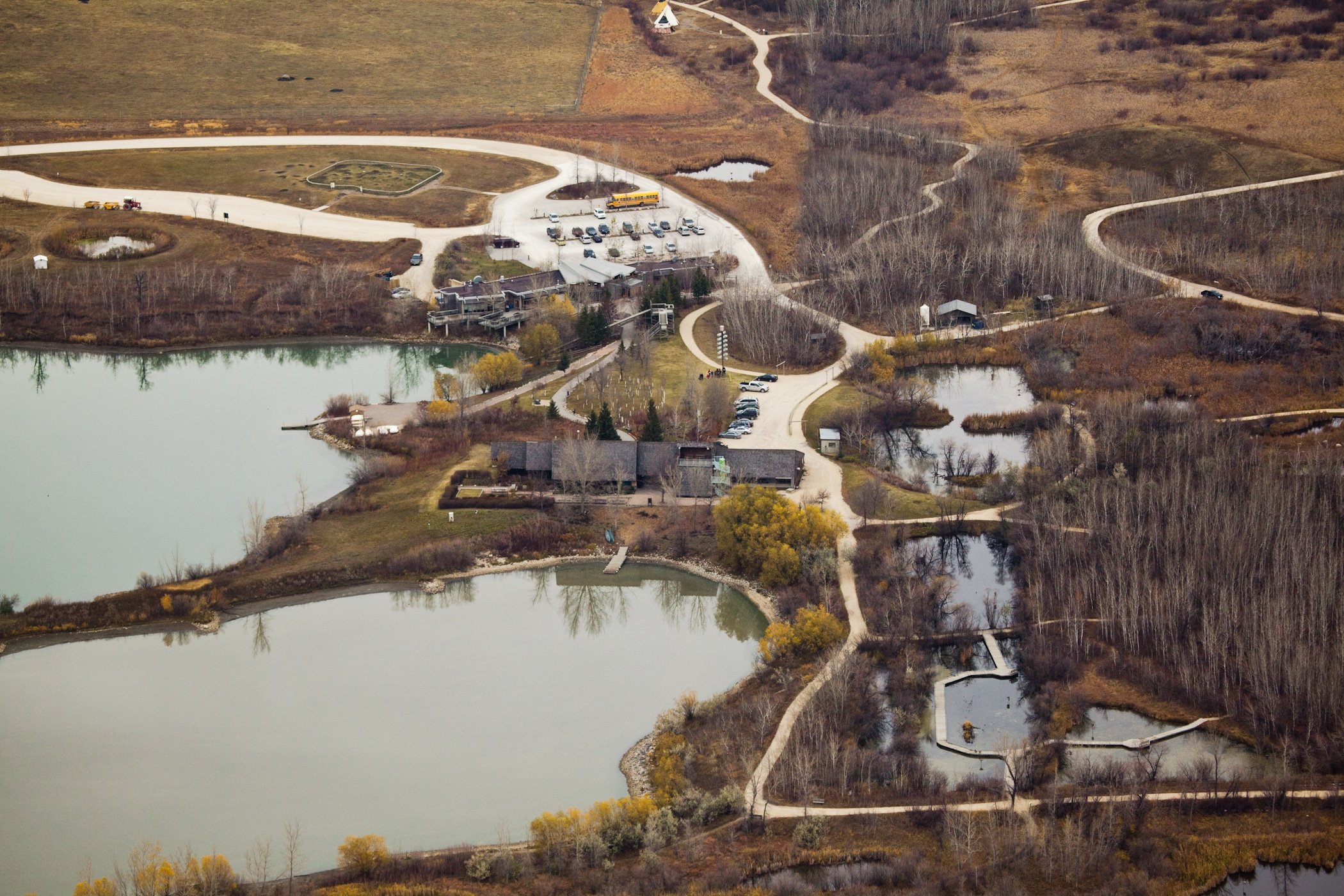 Aerial of FortWhyte trails and lakes in spring