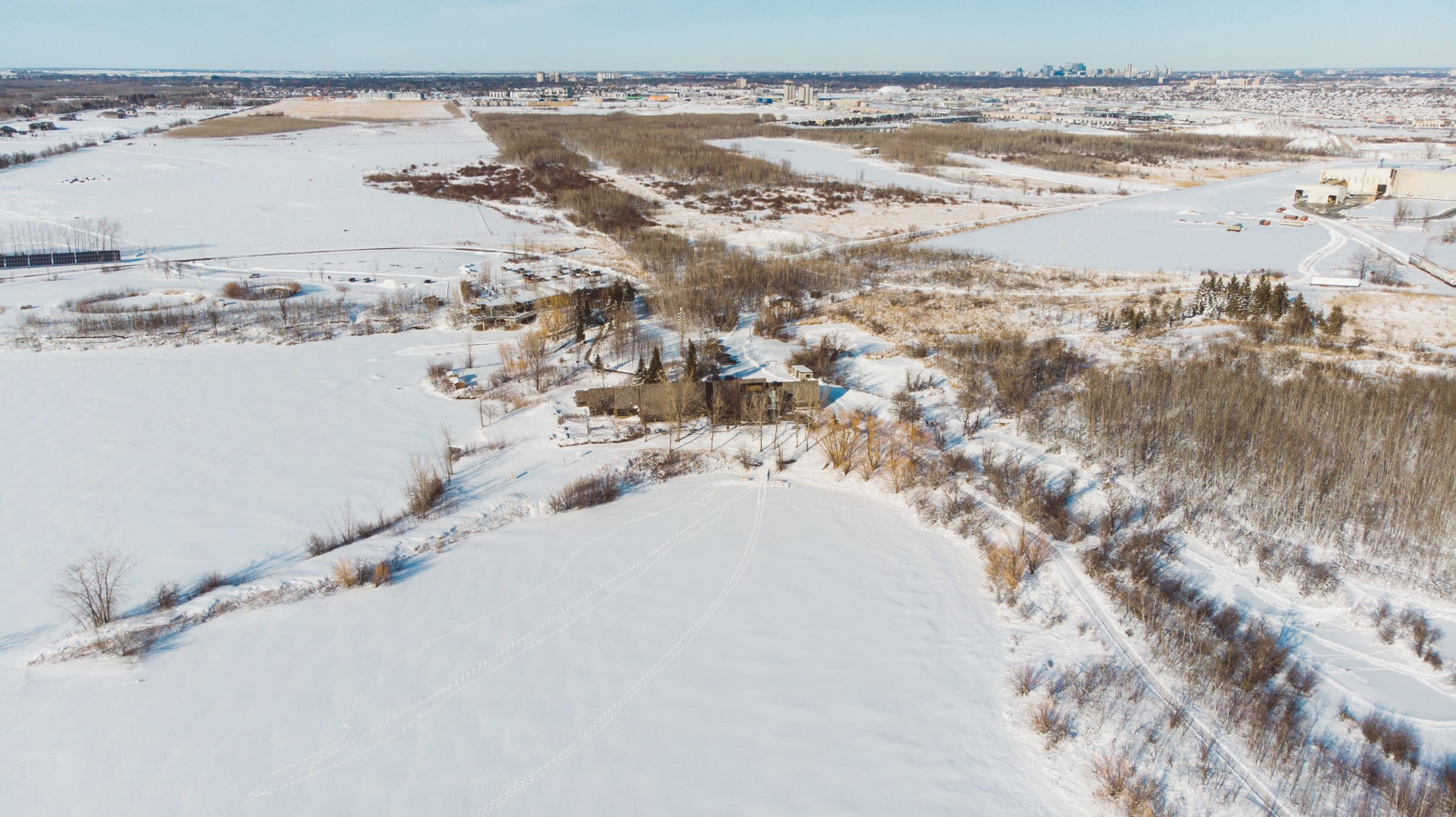 Aerial shot of FortWhyte in winter.