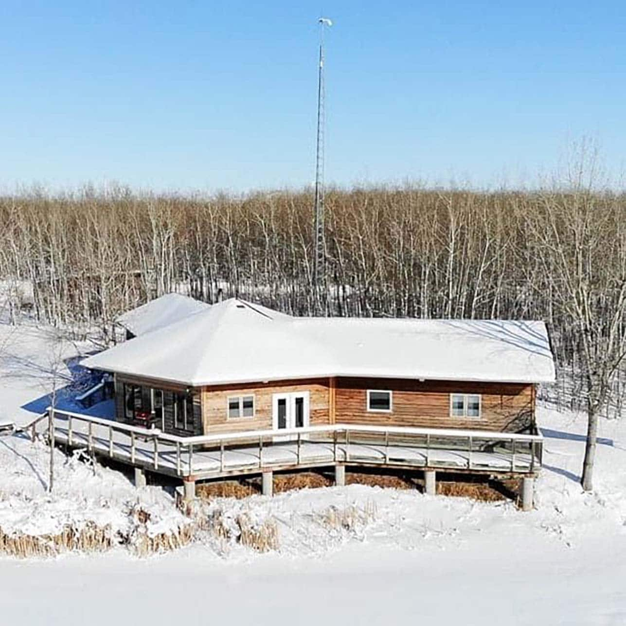 aerial view of the field station and the surrounding lake covered in snow
