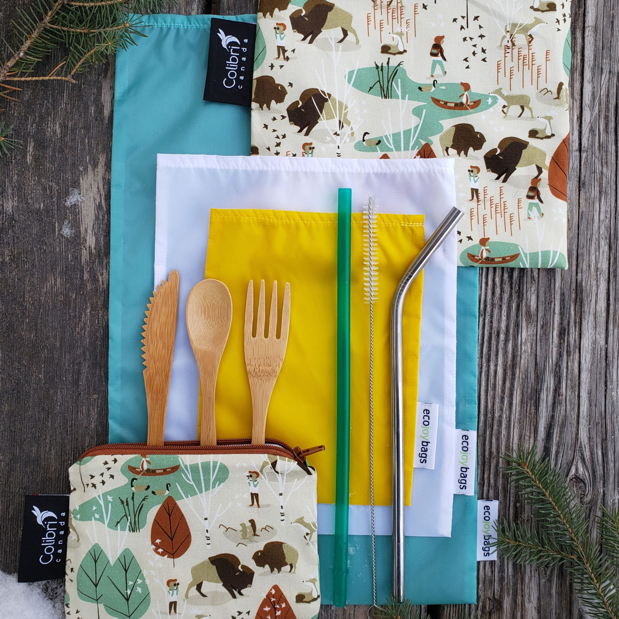 Sustainable supplies from the Nature Shop, including bamboo cutlery, a metal straw, and cloth bags.