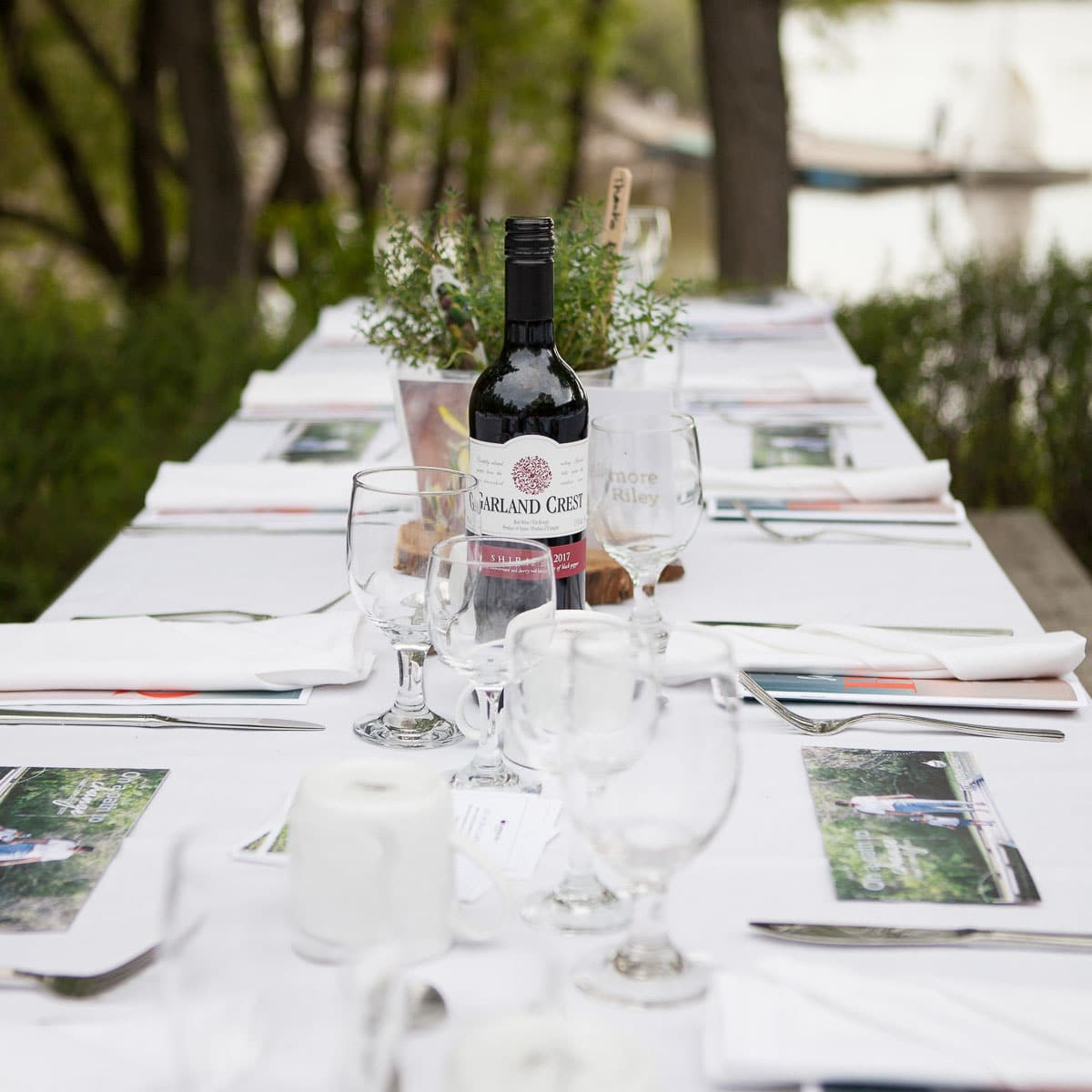 An elegant table setting outside on FortWhyte Alive's lakeside patio.