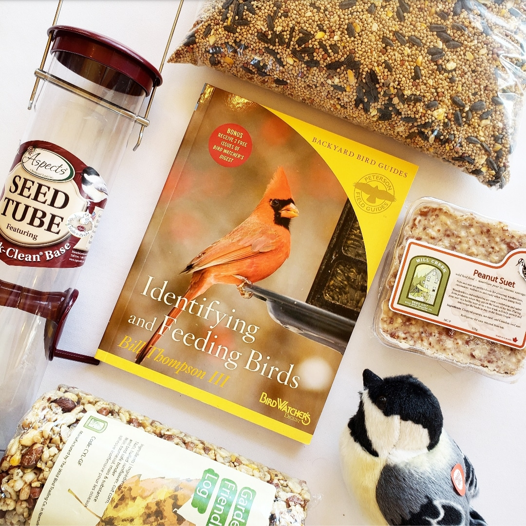 Assortment of bird seed and birding guide books