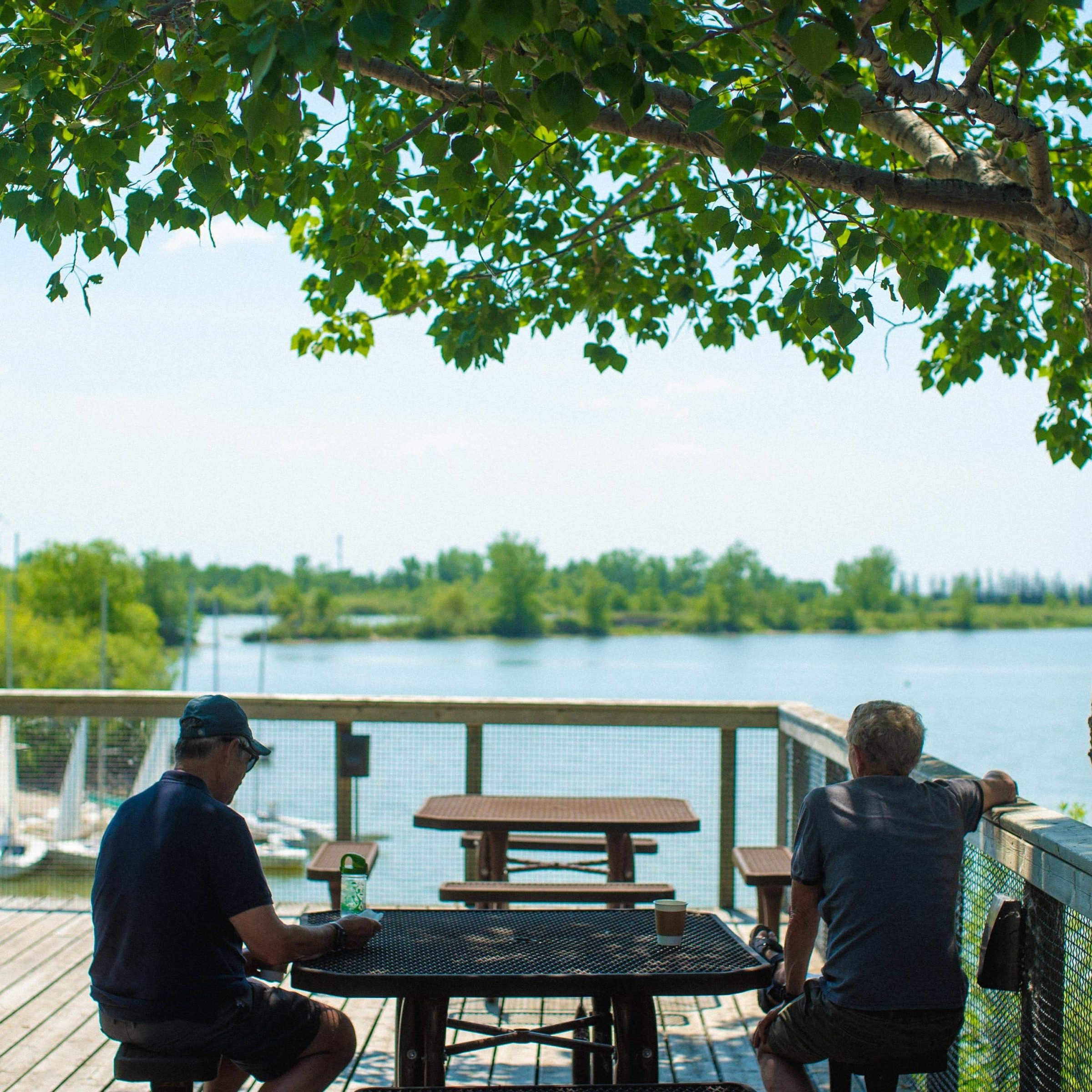 Two visitors sitting at a table on the deck of Buffalo Stone Cafe