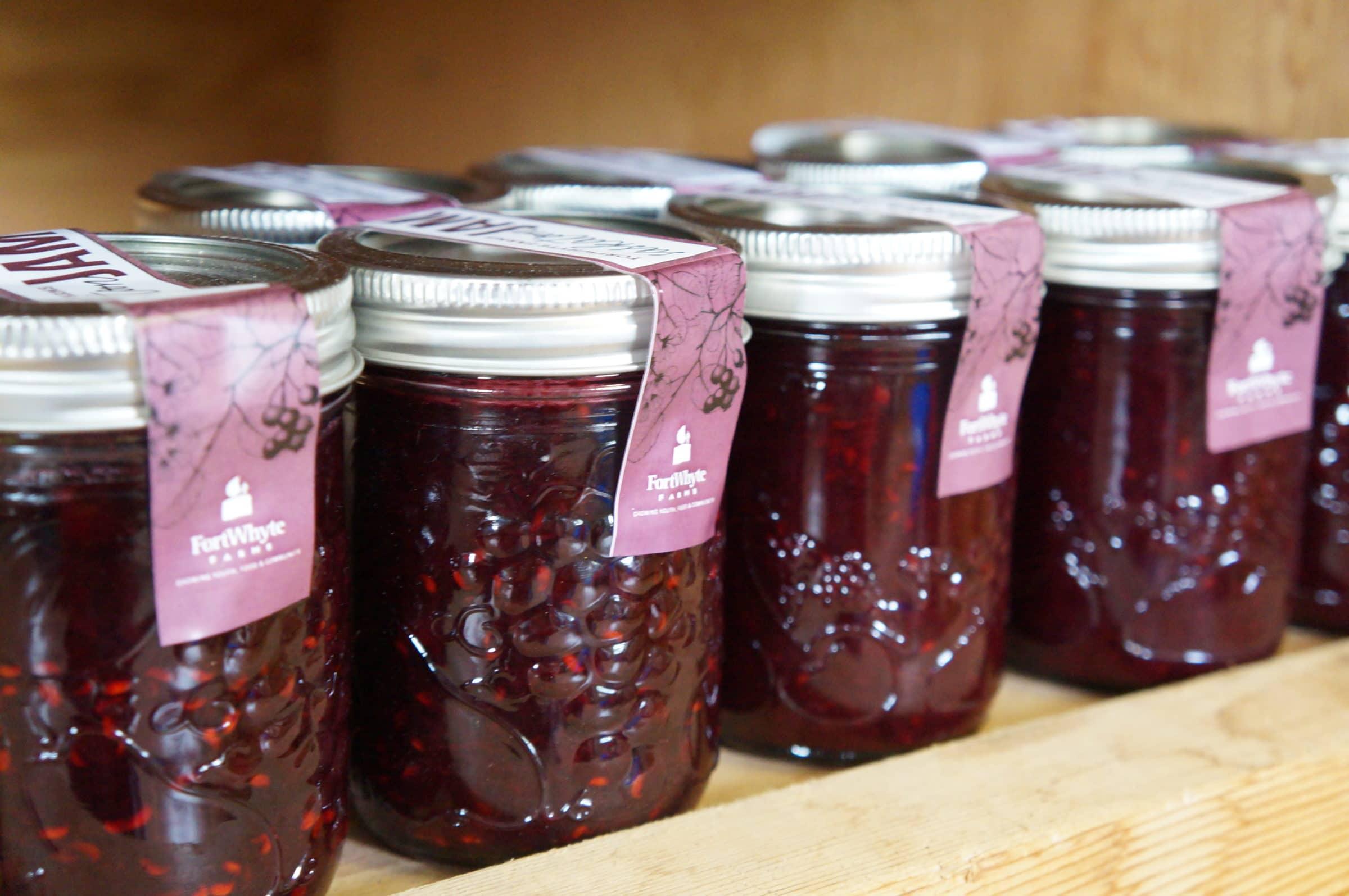 Jars of FortWhyte Farms berry jam on a shelf