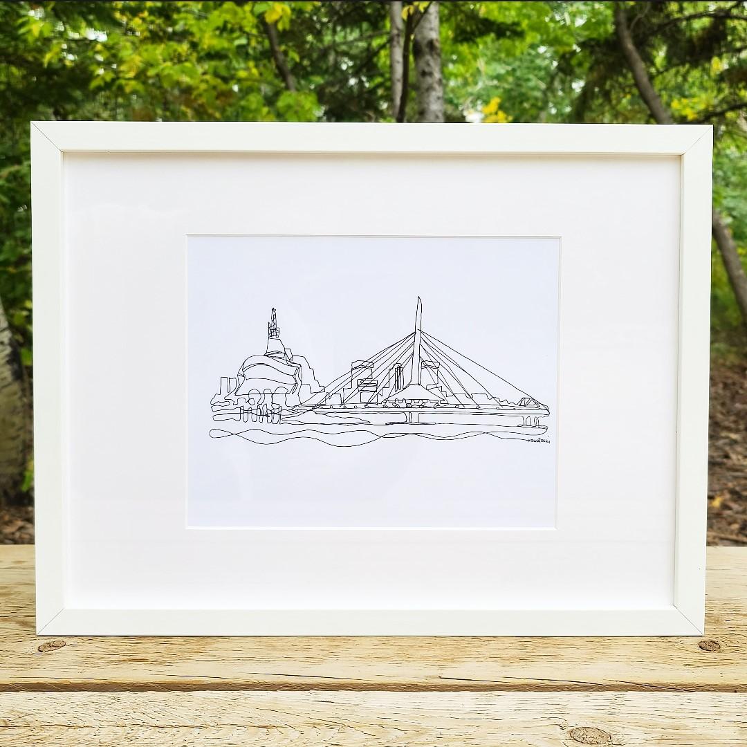 White framed photo of a line drawing of the Provencher bridge in Winnipeg by Kal Barteski.