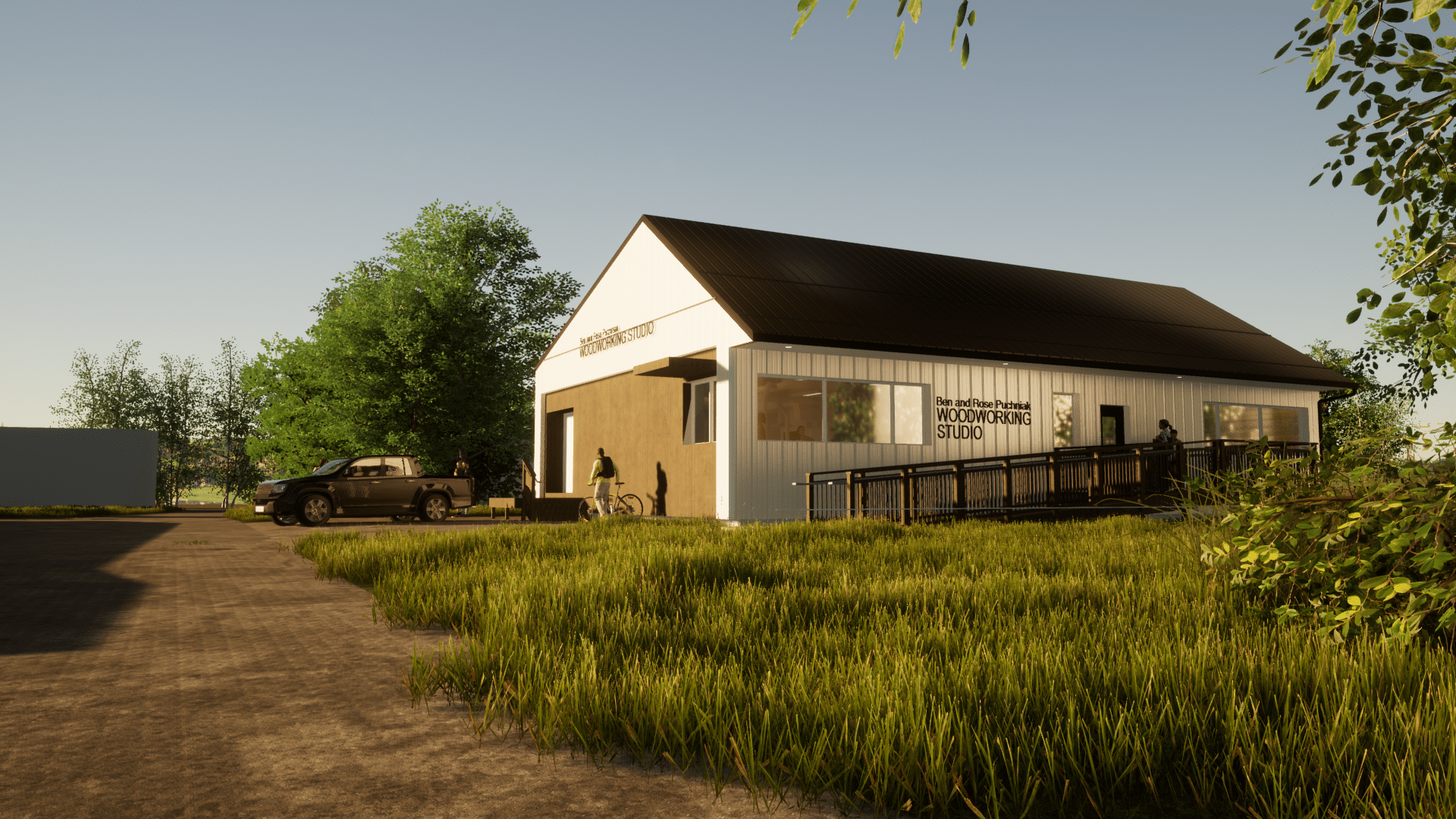 A rendering of the Ben and Rose Woodworking Studio in summer. A cream colour building is lit by the warm glow of a setting sun. Uncut grass surrounds it.